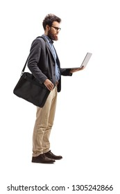 Full length shot of a man standing with a shoulder bag and holding a laptop isolated on white background