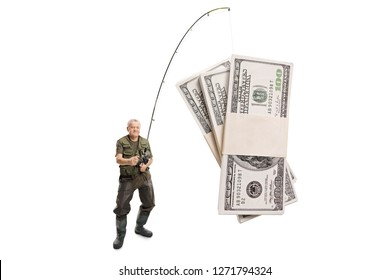 Full length shot of a mature fisherman catching money with a fishing rod isolated on white background
