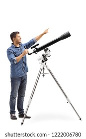 Full length shot od a man standing next to a telescope and pointing up isolated on white background