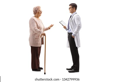 Full length shot of an old lady with a cane talking to a young male doctor isolated on white background