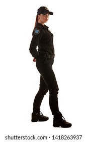 Full length shot of a redheaded female police officer posing for the camera isolated on white background.