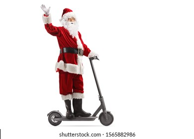 Full length shot of Santa Claus waving from an electric scooter isolated on white background