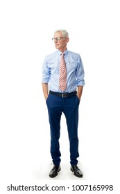 Full length shot of a senior businessman standing with rolled up sleeves shirt and tie at isolated white background.