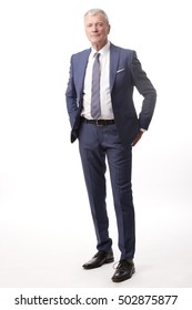 Full length shot of a senior businessman standing at isolated white background.