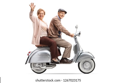 Full length shot of a senior couple riding a vintage scooter and waving isolated on white background