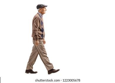 Full length shot of a senior man walking isolated on white background
