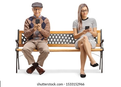 Full length shot of a senior man and a young lady sitting on a bench with smartphones isolated on white background