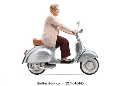 Full length shot of a senior woman riding a vintage scooter isolated on white background