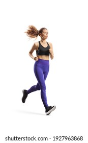 Full length shot of a slim young woman in sportswear running isolated on white background