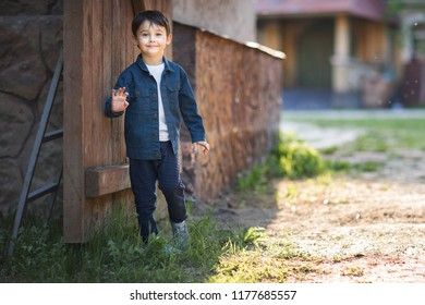 full length shot of smiling boy waving hand on the camera