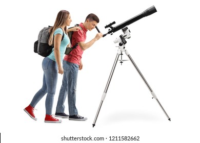 Full length shot of a teenage girl and boy looking through a telescope isolated on white background