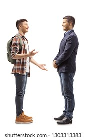 Full length shot of a teenage male student talking to a young man isolated on white background