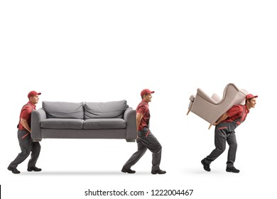 Full length shot of three movers carrying a couch and an armchair isolated on white background