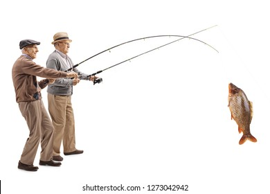 Full length shot of two senior fishermen with a big carp on a fishing rod isolated on white background
