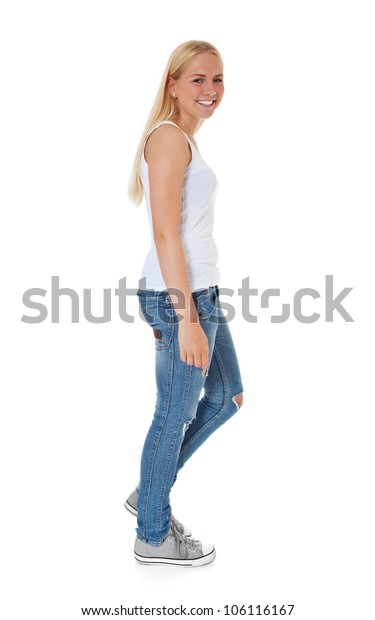 Full length shot of a walking girl. All on white background.