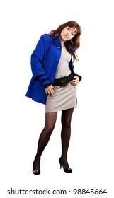 full length shot of woman in blue coat on white background