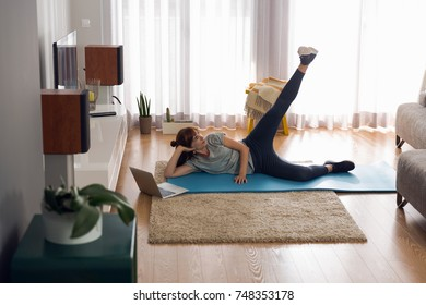 Full length shot of a woman doing exercise at home