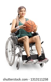 Full length shot of a woman in a wheelchair holding a basketball isolated on white background