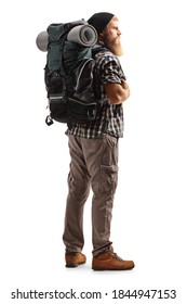 Full length shot of a young bearded man with a backpack and hiking equipment isolated on white background