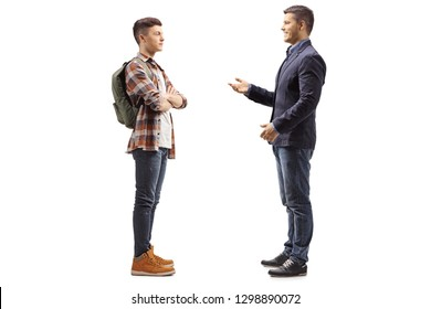 Full length shot of a young boy listening to a man talking isolated on white background