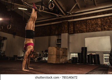 Full length shot of a young fitness woman doing handstand at the gym copyspace workout training balance athletics sports motivation crossfit motivation determination concentration healthy lifestyle