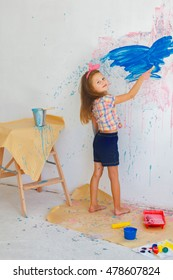 Full Length Shot of a Young Little Kid Painting Something