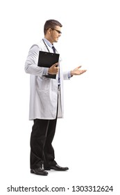 Full length shot of a young male doctor in a lab coat standing and gesturing a conversation isolated on white background