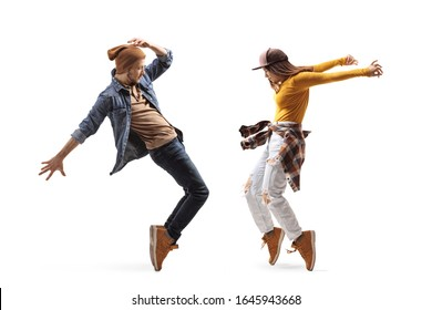 Full length shot of a young male and female dancing isolated on white background
