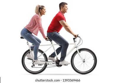 Full length shot of a young man and woman riding a tandem bicycle isolated on white background
