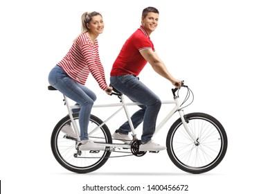 Full length shot of a young man and woman on a tandem bicycle looking at the camera isolated on white background