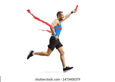 Full length shot of a young man finishing a relay race and holding a baton isolated on white background