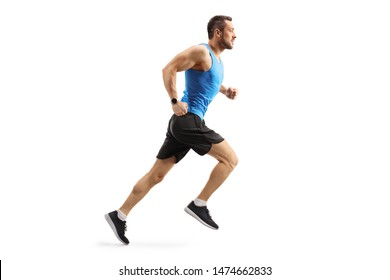 Full length shot of a young man in sportswear running isolated on white background
