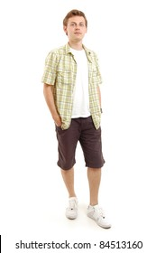 full length shot of a young man in yellow shirt, isolated on white