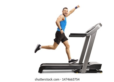 Full length shot of a young muscular man running on a treadmill and gesturing with hand isolated on white background