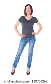 full length shot of young smiley girl in grey t-shirt and blue jeans