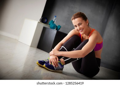 Full length shot of a young woman sitting at the gym and relaxing before starting workout.