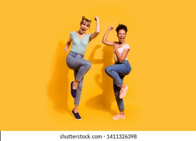 Full length side profile body size photo beautiful winners she her lady different nationalities hands arms fists wild yell wear casual white striped t-shirt clothes isolated yellow bright background