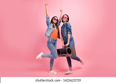 Full length side profile body size photo beautiful she her best ladies festive mood hands arms raised listen playlist vintage recorder wear jeans denim jackets blazers isolated bright pink background