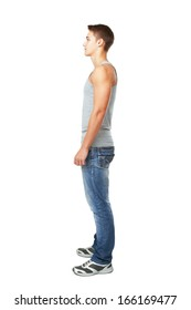 Full length side view portrait of young man isolated on white background