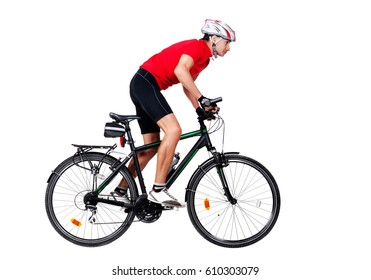 Full length side view  portrait of a cyclist riding his mountain bicycle in a white studio