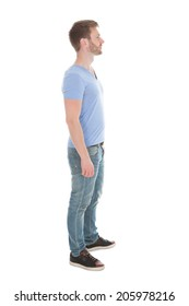 Full length side view of young man standing isolated on white background