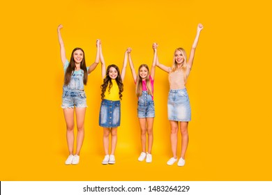Full length size body photo of two pairs of moms and her pretty kids raising arms up having cool weekend isolated vivid background