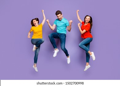 Full length size body photo of three group of people one handsome crazy guy and two beautiful emotional ladies celebrating triumph isolated violet background