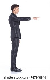Full Length Snap Figure, Business Man Stand in dark Blue Black Suit pants and shoes, pointing fingers hand presentation, rear back side view, studio lighting white background isolated,