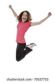 Full length studio photo of attractive woman jumping in air with arms extended. White background.