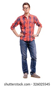 Full length studio portrait of handsome young man in plaid red shirt and jeans. Isolated on white.