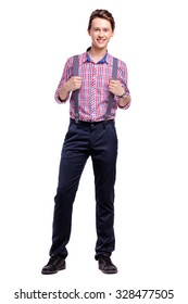 Full length studio portrait of handsome young man in plaid shirt with suspenders. Isolated on white.