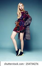 Full length studio shot of pretty fashion model