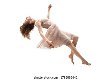 Full length studio shot of young woman hovering in air