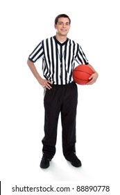 Full length teenage boy referee holding a basketball